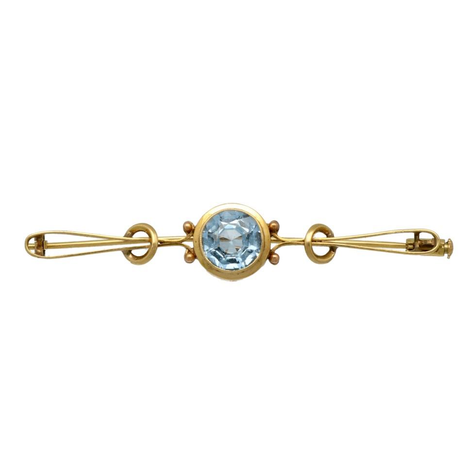 Gouden vintage broche met blauwe topaas