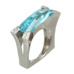 18 krt witgouden ring met topaas en diamant.